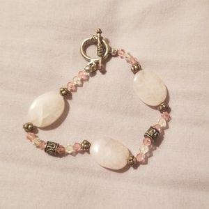 Pink beaded bracelet with pink gemstones